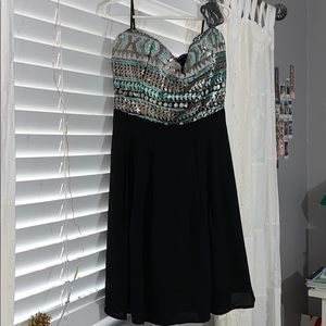 Forever 21 Dresses - A mini black dress, never worn!